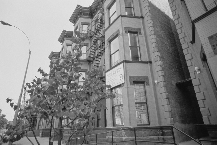 "FIGS. 3, 4: Bedford-Stuyvesant Restoration Corporation has created or preserved more than 2,200 units of housing and restored the facades of more than 150 homes. Pictured here are ""before"" and ""after"" views of one of the corporation's housing preservation projects from the early 1980s. Images are property of Pratt Center for Community Development."
