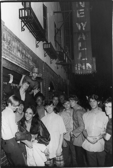 FIG. 1: Stonewall participants standing in front of the Stonewall Inn, June 29, 1969. Photograph by Fred W. McDarragh/Getty Images.