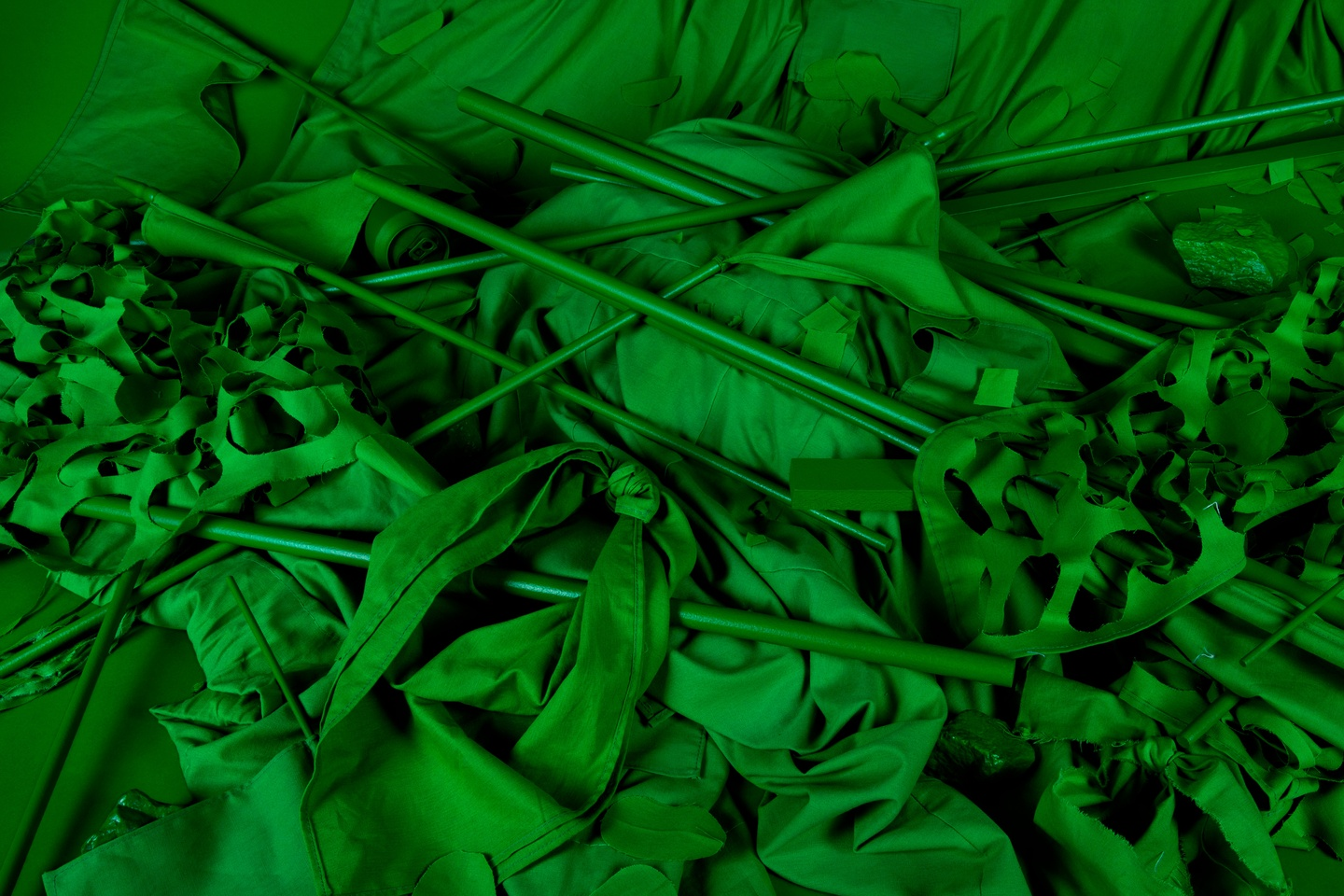 Photograph of protest props, fabricated entirely in bright green chroma key color.