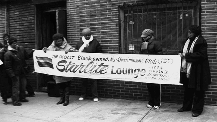 "FIG. 9: Patrons of Brooklyn's Starlite Lounge, ""The Oldest Black-Owned, Non-Discrimination Club,"" protesting its closing, ca. 2010, film still from We Came to Sweat, directed by Kate Kunath, 2014."