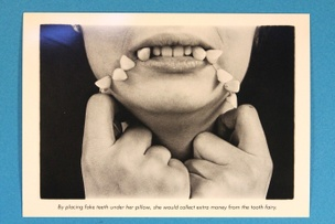 By placing fake teeth under her pillow... Postcard