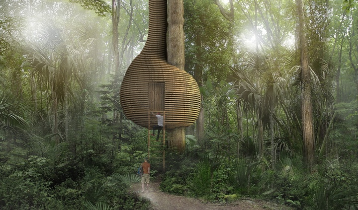 """Rendering of a round """"treehouse"""" structure in the woods, that appears to have a ribbed wooden exterior. An individual is showing climbing a ladder up to it."""
