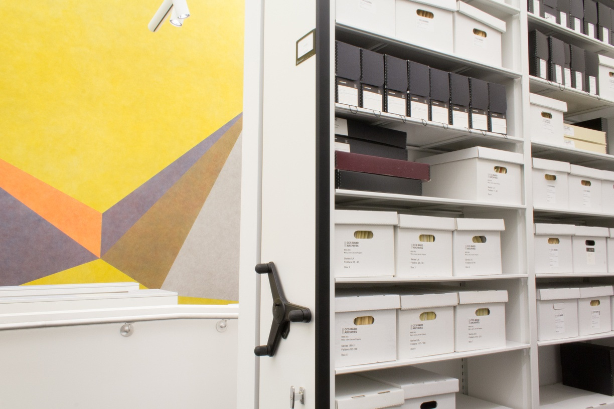 Archives stacks with LeWitt work in background