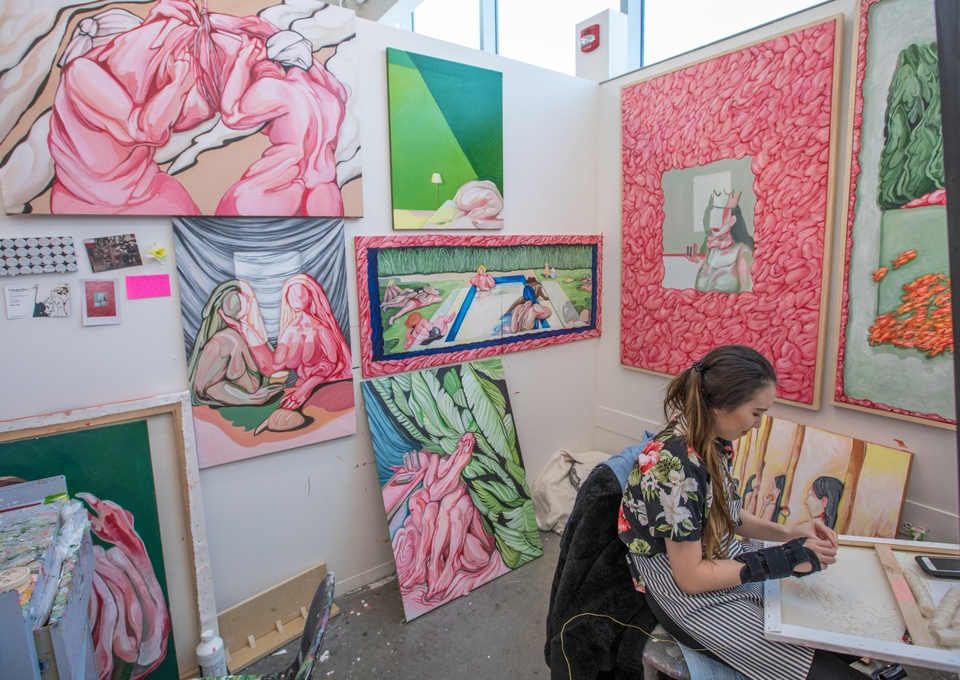 Studio art space filled with colorful paintings.