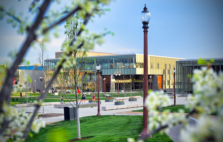 Wide shot of the Sam Fox School campus in springtime.