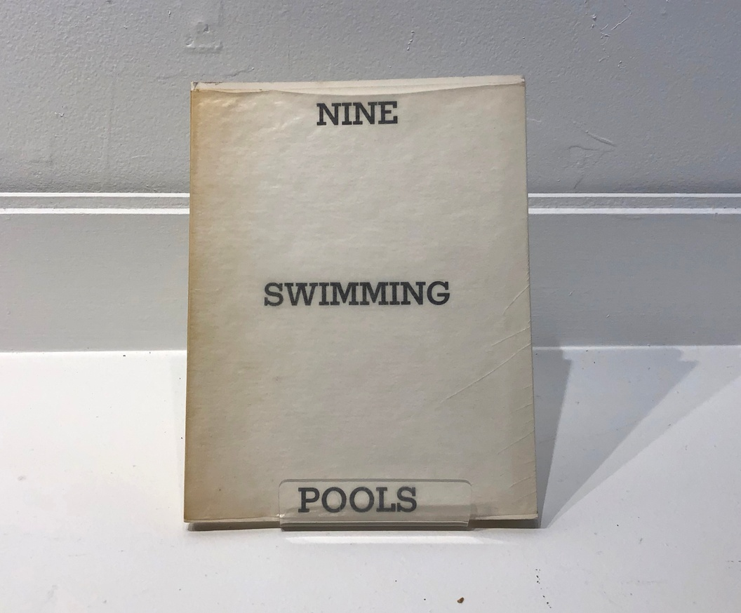 Nine Swimming Pools and a Broken Glass