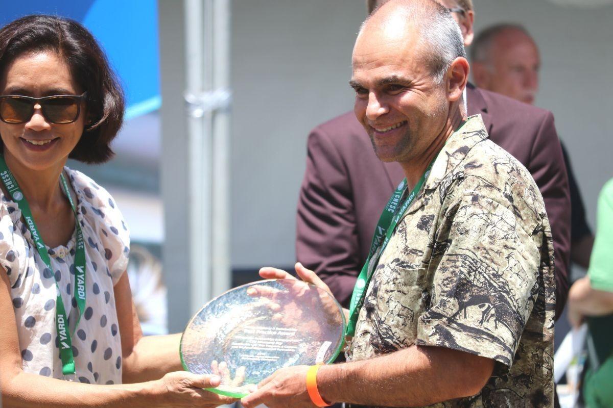 Dr. Daniel Fernandez accepts CHESC award on behalf of CSUMB