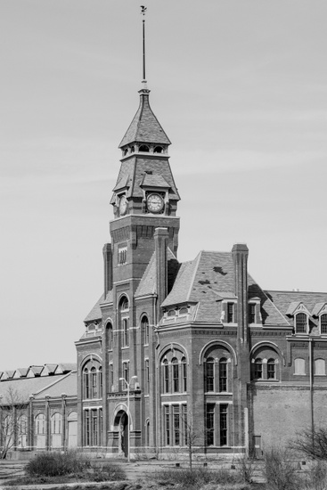 FIG. 1: The Pullman Clock Tower and Administration Building will serve as the visitor center for the Pullman National Monument, recognizing the first planned industrial community in the United States. Along with the Pullman factory, which produced railroad cars, the model town housed a diverse community—more than half of residents were foreign-born—with a population of over 8,000 at its peak in the mid-1880s. The 1894 Pullman Strike was a historic turning point in US labor law. When Pullman workers went on strike after a reduction in wages, other members of the American Railroad Union supported their cause by refusing to add or remove Pullman cars from trains, thereby disrupting rail service across the country and prompting the first-ever federal injunction to block a strike. Image courtesy of Marc PoKempner.