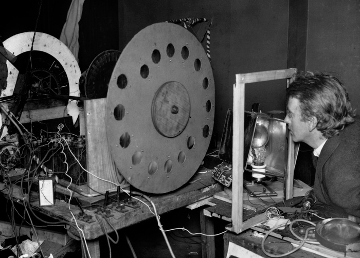 "John Logie Baird with his ""televisor,"" circa 1926. © Hulton-Deutsch Collection/ Corbis Historical via Getty Images."