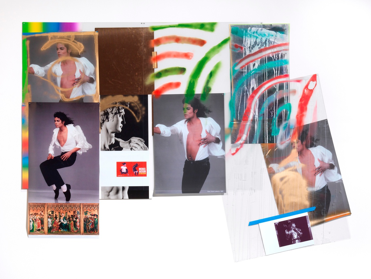 In a colorful collage, multiple posters of a dancing Michael Jackson mingle with two metallic panels and a poster of Michelangelo's famous sculpture, David. In one poster, MJ is mid-dance-move balancing on his tip-toes; he seems to defy gravity. Bronze spray paint adorns the head of David and the head and chest of one of the Michaels. The body of another Michael, covered by an angled rectangle of clear plastic, seems to meet a cloud of bronze paint mid-air. That Michael has a smaller Michael attached to it with blue tape. Soft curved stripes of red, green, and turquoise spray paint, and a hard dripping stripe of white, overlay the upper right side of the piece. In the lower left corner is a small reproduction of an elaborate gilded triptych depicting the Three Kings at the birth of Jesus.