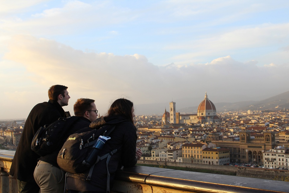 Three students overlooking Florence, Italy at sunset.