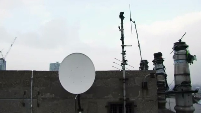"Fig 4: Rooftop pirate radio transmitters in London. Still from a short documentary by Palladium Boots for its Exploration film series. [""London Pirate Radio""](www.youtube.com/watch?v=1E0yqCPd5PY), YouTube, March 25, 2015. © VBS.IPTV."