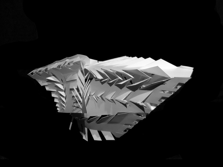 Architectural model built out of white paper in a streamlined shape with rows of angular flaps cut out along the ridges of the object.